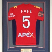 Signed Adelaide United top with plaque.